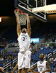 Nevada's AJ West dunks against Northwest Christian during a college basketball game in Reno, Nev., on Sunday, Dec. 28, 2014. Nevada won 81-67.<br /> Photo by Cathleen Allison