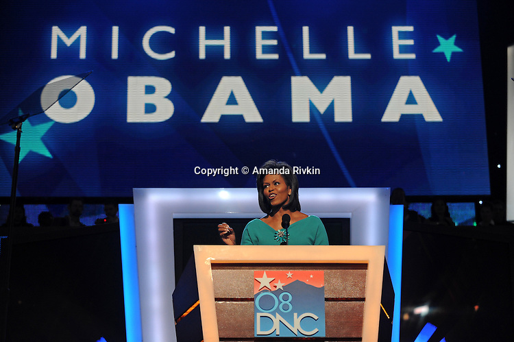 Michelle Obama, wife of presumptive Democratic presidential candidate Barack Obama, speaks at the Democratic National Convention at the Pepsi Center in Denver, Colorado on August 25, 2008.