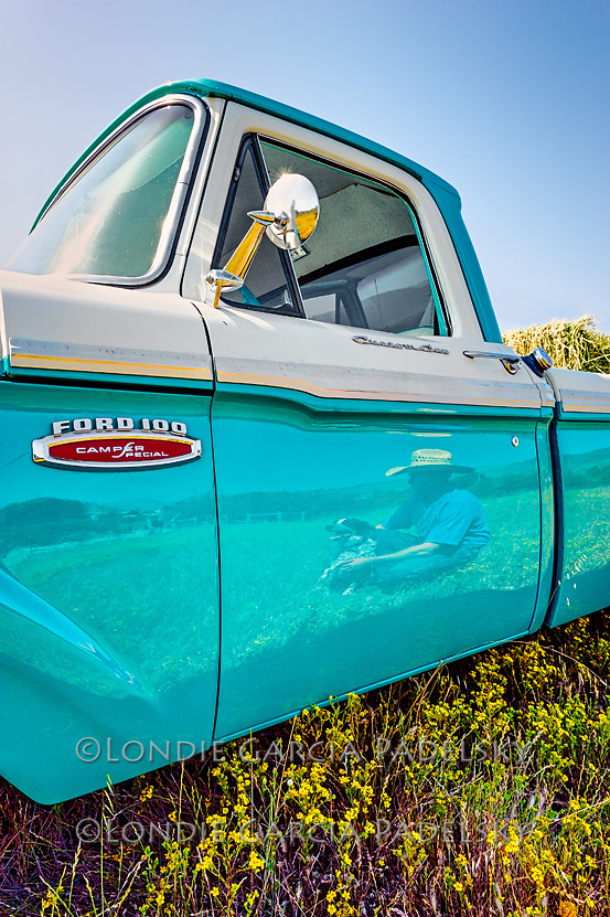 Cowboy reflection in the door of his1968 Ford Truck