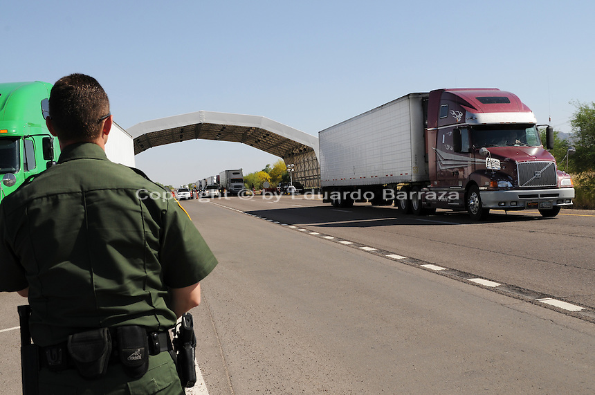 Nogales, Arizona - U.S. Customs Border Protection (CBP) Public Affairs officer Brent Cagen looks toward the location of a permanent U.S. Customs and Border Protection (CBP) traffic checkpoint located on highway Interstate 19, north from Nogales and near the Town of Tubac, Arizona. Border Patrol checkpoints serve as inspection stations to detect illegal immigration and drug smuggling. Border Patrol agents assigned to fixed traffic checkpoints may stop a vehicle for brief questioning of its occupants. This checkpoint is part of the Border Patrol Tucson Sector. Photo by Eduardo © 2012