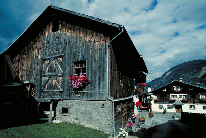 Traditional style Swiss home with barn attached. Disentis, Switzerland Europe.