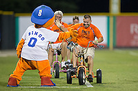 A fan gets ready to slap hands with Burlington Royals mascot Bingo after winning a between innings contest during the game against the Bluefield Blue Jays at Burlington Athletic Stadium on June 27, 2016 in Burlington, North Carolina.  The Royals defeated the Blue Jays 9-4.  (Brian Westerholt/Four Seam Images)