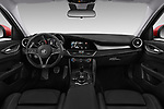 Stock photo of straight dashboard view of a 2017 Alfa Romeo Giulia Veloce 4 Door Sedan
