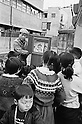 "February 1965: ""Kamishibai"" paper drama story teller performing in the streets during the Showa period. (Photo by Katsuro Okazawa/AFLO)"