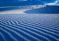 796650022 low angled afternoon light creates a three-dimensional effect in the dune ripples in the gypsum dunes of white sands national monument in new mexico