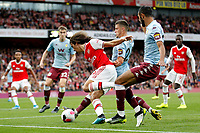Mattéo Guendouzi of Arsenal tackled by Frédéric Guilbert of Aston Villa during the Premier League match between Arsenal and Aston Villa at the Emirates Stadium, London, England on 22 September 2019. Photo by Carlton Myrie / PRiME Media Images.
