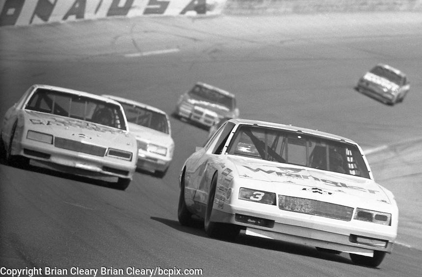 Daytona 500, Daytona International Speedway, Daytona Beach, FL, February 16, 1986.  (Photo by Brian Cleary/www.bcpix.com) Dale Earnhardt leads the pack off turn four