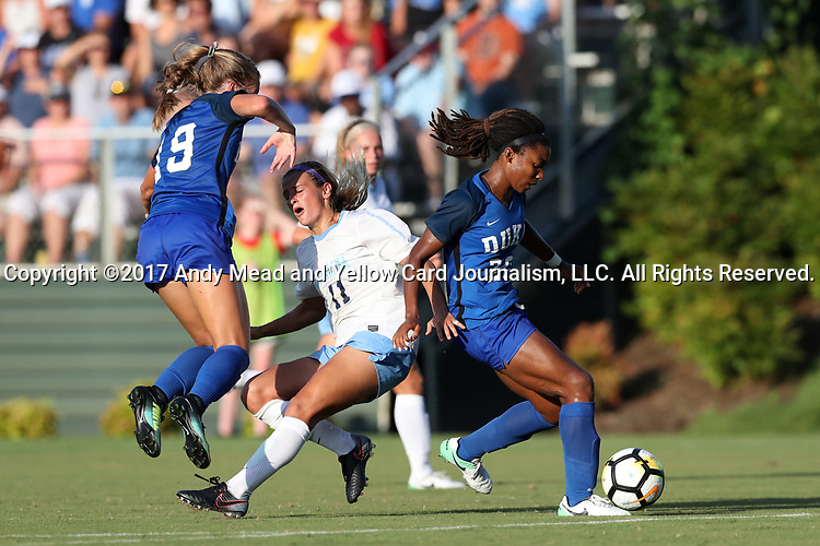 CARY, NC - AUGUST 18: North Carolina's Emily Fox (11) is run off the ball by Duke's Mia Gyau (20) and Schuyler DeBree (19). The University of North Carolina Tar Heels hosted the Duke University Blue Devils on August 18, 2017, at Koka Booth Stadium in Cary, NC in a Division I college soccer game.