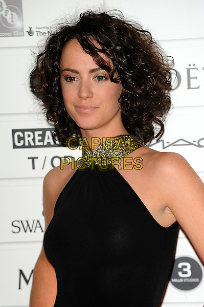 Amy Manson.The 14th Moet British Independent Film Awards 2011, Old Billingsgate, London, England..December 4th, 2011.half length black dress green collar beads beaded .CAP/CJ.©Chris Joseph/Capital Pictures.