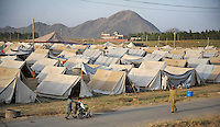 An area of the Swabi Refugee camp. The camp is run by Red Cross/Red Crescent (ICRC), and currently houses around 18,000 refugees. The Pakistani government began an offensive against the Taliban in the Swat Valley in April 2009, which led to a major humanitarian crisis. Up to two million civilians were estimated to have been displaced by the fighting.