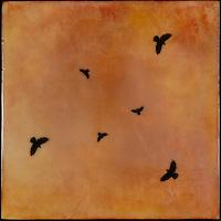Encaustic painting of crows swirling in orange sunset sky.