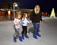 STAFF PHOTO BEN GOFF  @NWABenGoff -- 12/10/14 Lisa Jescheling, from right, skates with her daughters Hayden Jescheling, 7, and Kendyl Jescheling, 5, during the Disney's 'Frozen'-themed Wild Wardrobe Wednesday at The Rink at Lawrence Plaza in downtown Bentonville on Wednesday Dec. 10, 2014. The Rink encourages patrons to dress up in their best costume for the Wild Wardrobe Wednesday theme each week through Jan. 14.