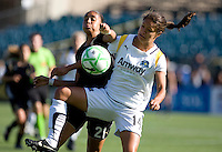 Adriane (21) and Stephanie Cox (14) battle for the ball. Los Angeles Sol defeated FC Gold Pride 2-0 at Buck Shaw Stadium in Santa Clara, California on May 24, 2009.