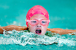 Cottonwood's Audrey Nielson competes in the 50 yard fly race during the 53rd annual Country Club Swimming Championships on Tuesday, Aug. 7, 2012, in Kearns, Utah. (© 2012 Douglas C. Pizac)