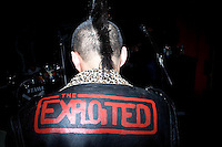 "A Chinese punk rock musician wears a leather jacket that says ""Exploited"" while waiting for his set to begin at a concert in Nanjing, China."