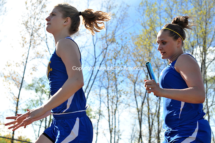 WOODBURY, CT - 7 May 2013-050713EC03--   Housatonic's Katie Heacox prepares to hand the baton to Brianna Hoyt Tuesday during the 4x100m event. Housatonic won the race against Nonnewaug and Wamogo. Erin Covey Republican-American.