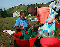 Rwandan orphans do their laundry in the AmeriCares clinic compound where they lived in October, 1994. Many children were separated from their parents during the exodus from Rwanda to Goma, Zaire (now Congo)to flee genocide and civil war in 1994. Many didn't know whether they were actually orphans or rather simply separated. The clinic, run by the New Canaan, Connecticut humanitarian organization also had a tent for about 15 of these children. The clinic was located in Buranga, halfway between Kigali and Goma.
