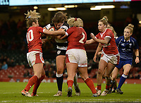 Jenny Murphy of Barbarians is tackled by Kelsey Jones of Wales and Elinor Snowsill<br /> <br /> Photographer Ian Cook/CameraSport<br /> <br /> 2019 Autumn Internationals - Wales Women v Barbarians Women - Saturday 30th November 2019 - Principality Stadium - Cardifff<br /> <br /> World Copyright © 2019 CameraSport. All rights reserved. 43 Linden Ave. Countesthorpe. Leicester. England. LE8 5PG - Tel: +44 (0) 116 277 4147 - admin@camerasport.com - www.camerasport.com