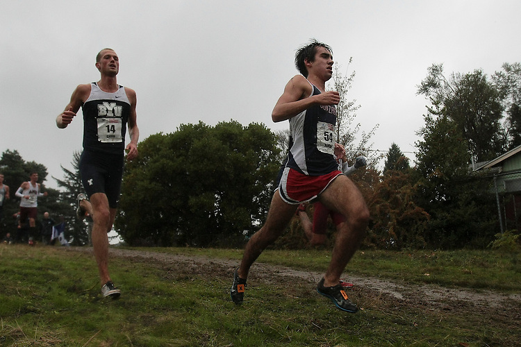 October 27, 2012; Portland, OR, USA; BYU Cougars runner Curtis Carr (14), Gonzaga Bulldogs runner Nick Roche (54) during the WCC Cross Country Championships at Fernhill Park.