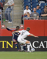 New England Revolution midfielder Sainey Nyassi (31) works the wing against D.C. United defender Bryan Namoff (26) .The New England Revolution tied DC United, 2-2, in Gillette Stadium on May 29, 2008.