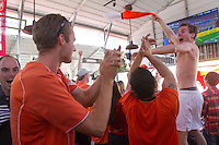 San Francisco, CA - Sunday, June 29, 2014: Dutch fans celebrate a goal at the SOMA StrEat Food Park watching the Netherlands vs. Mexico round of 16 World Cup match.
