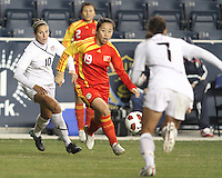 Carli Lloyd #10 and Shannon Boxx #7 of the USA WNT close in on Shanshan Qu #19 of the PRC WNT during an international friendly match at PPL Park, on October 6 2010 in Chester, PA. The game ended in a 1-1 tie.