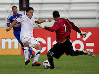 Esteban Rodriguez (9) of the United States has the ball cleared away from him by Sandy Sanchez (1) of Cuba during the first day of the group stage at the CONCACAF Men's Under 17 Championship at Catherine Hall Stadium in Montego Bay, Jamaica. The United States defeated Cuba, 3-1.