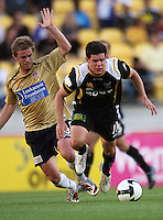 Newcastle's Matt Thompson fouls Troy Hearfield during the A-League match between Wellington Phoenix and Newcastle Jets at Westpac Stadium, Wellington, New Zealand on Sunday, 4 January 2009. Photo: Dave Lintott / lintottphoto.co.nz