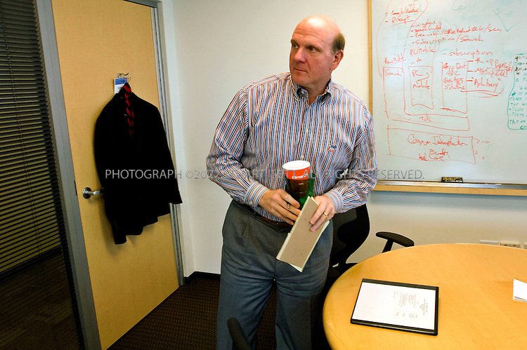 1/23/2006--Redmond, WA, USA..12.52pm: Steve Ballmer, CEO of Microsoft, heads out from his office to the conference room next door after lunch for a meeting. Ballmer's office is on the 5th floor of a building on the Microsoft campus and is surprisingly small, spartan and understated...Photograph ©2007 Stuart Isett.All rights reserved