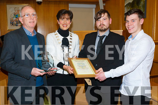 The KDYS were honoured at the Tralee Municipal District Awards this week. <br /> Left to right Fr Ger Godley, Mayor Cllr Norma Foley, Joshua Sanders and Conor Horgan.