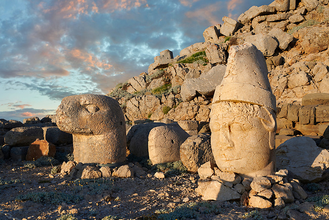 Statue heads at sunrise, from lright,  Antiochus & Eagle  in front of the stone pyramid 62 BC Royal Tomb of King Antiochus I Theos of Commagene, east Terrace, Mount Nemrut or Nemrud Dagi summit, near Adıyaman, Turkey