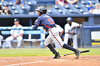 Rome Braves left fielder Justin Ellison (5) swings at a pitch during a game against the Asheville Tourists at McCormick Field on May 22, 2017 in Asheville, North Carolina. The Braves defeated the Tourists 7-3. (Tony Farlow/Four Seam Images)
