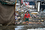 A girl in an illegal Roma settlement in Belgrade, Serbia, in February 2012. The families that lived here, most of whom survive from recycling cardboard and other materials, were forcibly evicted in April 2012. Many were moved into metal shipping containers on the edge of Belgrade..
