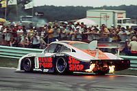 The Porsche 935 driven by John Paul, Jr., and Preston Henn during the 1983 IMSA race at Road America near Elkhart Lake, Wisconsin.