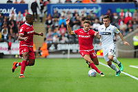 Matty Cash of Nottingham Forest vies for possession with Declan John of Swansea City  during the Sky Bet Championship match between Swansea City and Nottingham Forest at the Liberty Stadium, in Swansea, Wales, UK. Saturday 15 September 2018
