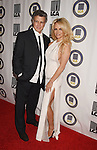 BEVERLY HILLS, CA - OCTOBER 24: Actress Pamela Anderson (R) and Last Chance for Animals president & founder Chris DeRose attend the Last Chance for Animals Benefit Gala at The Beverly Hilton Hotel on October 24, 2015 in Beverly Hills, California.