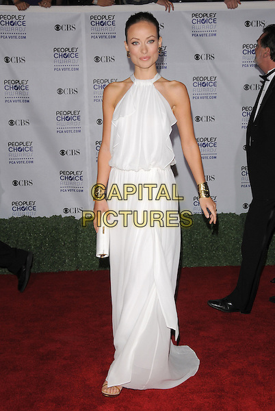 OLIVIA WILDE.Arrivals at the 35th Annual People's Choice Awards held at The Shrine Auditorium in Los Angeles, California, USA..January 7th, 2009.full length white dress grecian clutch bag gold bracelets sheer halterneck .CAP/DVS.©Debbie VanStory/Capital Pictures.