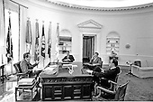 Washington, D.C. - April 21, 1969 -- United States President Richard M. Nixon meets senior staff in the Oval Office of the White House in Washington, D.C. on April 21, 1969.  Pictured from left to right: President Nixon; H.R. Haldeman, Assistant to the President; Donald Rumsfeld, Director of the Office of Economic Opportunity and Assistant to the President;  John D. Ehrlichman, Counsel to the President.<br /> Credit: White House via CNP