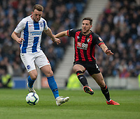 Bournemouth's Dan Gosling (right) vies for possession with Brighton & Hove Albion's Dale Stephens (left) <br /> <br /> Photographer David Horton/CameraSport<br /> <br /> The Premier League - Brighton and Hove Albion v Bournemouth - Saturday 13th April 2019 - The Amex Stadium - Brighton<br /> <br /> World Copyright © 2019 CameraSport. All rights reserved. 43 Linden Ave. Countesthorpe. Leicester. England. LE8 5PG - Tel: +44 (0) 116 277 4147 - admin@camerasport.com - www.camerasport.com