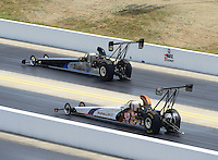 Apr. 14, 2012; Concord, NC, USA: NHRA top alcohol dragster driver Rich McPhillips (near lane) races alongside Richard Bourke during qualifying for the Four Wide Nationals at zMax Dragway. Mandatory Credit: Mark J. Rebilas-
