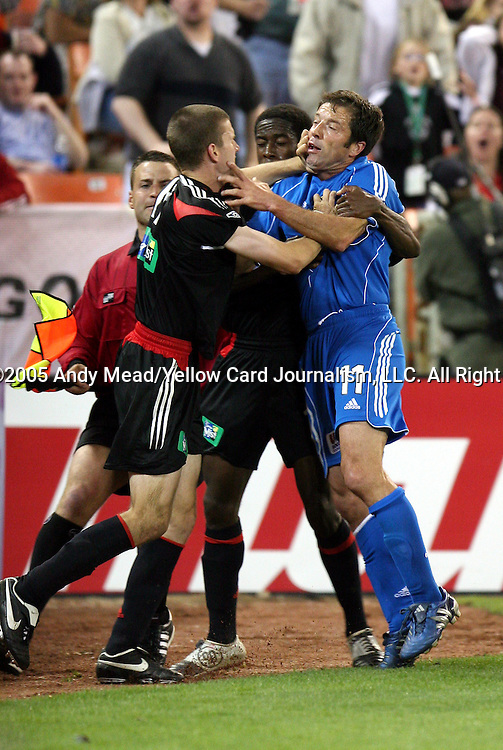 21 May 2005: Joshua Gros (left) and Preki (right) get into a shoving match in the 94th minute earning them both yellow cards. Clyde Simms (center) and assistant referee C.J. Morgante (behind, left) both step in to try and seperate them. DC United defeated the Kansas City Wizards 3-2 at RFK Stadium in Washington, DC in a regular season Major League Soccer game. . .