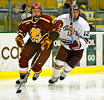 3 January 2009: Ferris State Bulldogs' defenseman Matt Case (left), a Junior from Plymouth, MN, keeps pace with Colgate Raiders' forward Brian Day, a Sophomore from Danvers, MA, during the consolation game of the 2009 Catamount Cup Ice Hockey Tournament hosted by the University of Vermont at Gutterson Fieldhouse in Burlington, Vermont. The two teams battled to a 3-3 draw, with the Bulldogs winning a post-game shootout 2-1, thus placing them third in the tournament...Mandatory Photo Credit: Ed Wolfstein Photo