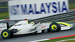 04 Apr 2009, Kuala Lumpur, Malaysia --- Brawn GP Formula 1 Team driver Jenson Button of Great Britain steers his car during the third practice session ahead the 2009 Fia Formula One Malasyan Grand Prix at the Sepang circuit near Kuala Lumpur. Photo by Victor Fraile --- Image by © Victor Fraile / The Power of Sport Images