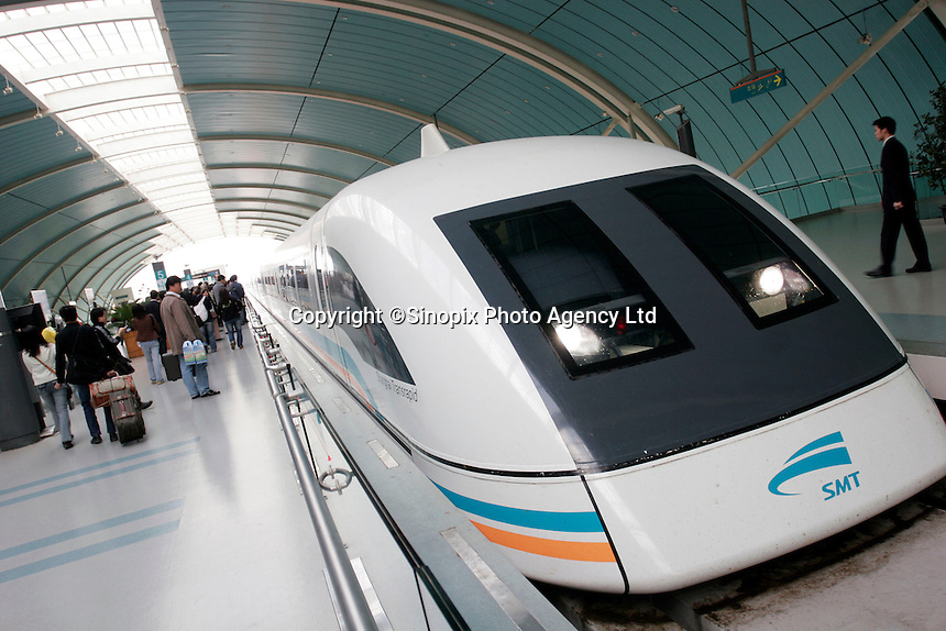 Longyang Road station, the terminus for the Maglev (magnetic levitation) train connecting Shanghai to Pudong airport. The Shanghai Maglev train, the first commercial high-speed maglev train in the world, can reach a maximum speed of 350km/h (220mph). The train runs from Longyang Road station to Pudong International airport 30 km away in 7 minutes 20 seconds..16 Nov 2005.