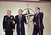 Press Conference following the visit Richard Holbrooke, United States Special Envoy, to North Atlantic Treaty Organization (NATO) headquarters in Brussels, Belgium on March 22, 1999 to discuss the crisis situation in Kosovo. Left to right:  U.S. Army General Wesley Clark, Supreme Allied Commander Europe (SACEUR); NATO Secretary General, Dr. Javier Solana; Richard Holbrooke.  General Clark is one of ten candidates running for the Democratic Party nomination for President of the United States..Credit: NATO via CNP