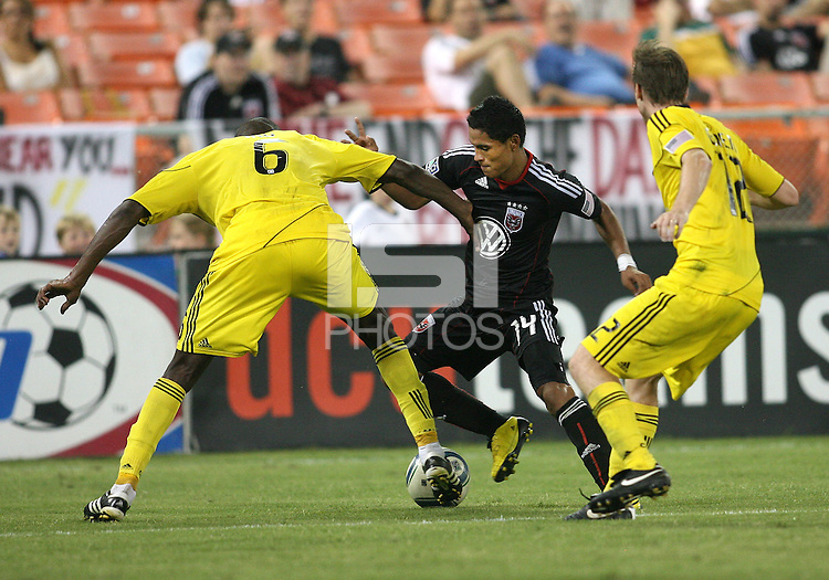 Andy Najar #14 of D.C. United cuts away from Andy Iro #6 and Eddie Gaven #12 of the Columbus Crew during a US Open Cup semi final match at RFK Stadium on September 1 2010, in Washington DC. Columbus won 2-1 aet.