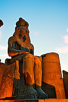 Statue of Ramses II at dusk, Luxor Temple located at modern day Luxor or ancient Thebes, Egypt.