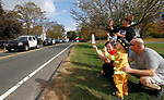 WOLCOTT, CT - 15 OCTOBER 2017 -101517JW01.jpg -- While dressed as a firefighter, Nicholas Tessier age 3 waves with his family of Deanna and Chris Tessier and Nancy Addessio as the 2nd Annual Wolcott First Responder Appreciation Day Parade passes by the Wolcott Green Sunday afternoon. Jonathan Wilcox Republican-American