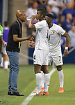 Panama head coach Julio Dely Valdes (left) talks with Fidel Escobar (4) of Panama and Jose Rodriguez (7) of Panama during their Gold Cup match on June 26, 2019 at Children's Mercy Park in Kansas City, KS.<br /> Tim VIZER/AFP