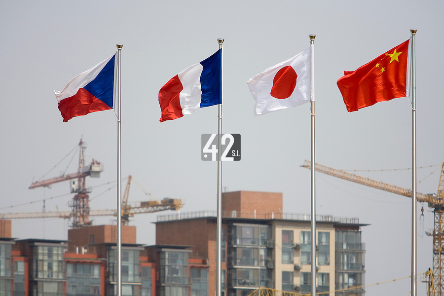 23 August 2007: From left to right, Czech Republic, France, Japan and China flags are seen during the France 8-4 victory over Czech Republic in the Good Luck Beijing International baseball tournament (olympic test event) at the Wukesong Baseball Field in Beijing, China.